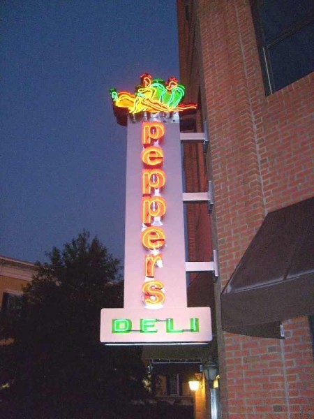 Wall mounted neon sign